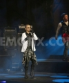 1420096858-marlon-roudette-and-band-tokio-hotel-perform-on-stage-for-new-year_6569339.jpg